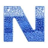 Metal la carta y riegue las gotas - letra N Fotografía de archivo libre de regalías