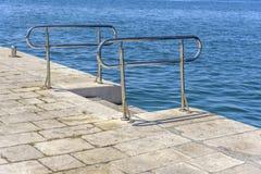 Metal la escalera para la pendiente en el agua Imagen de archivo libre de regalías