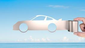 Metal la feuille de rouleau dans la forme de voiture de sport, concept économiseur d'énergie Image stock