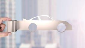 Metal la feuille de rouleau dans la forme de voiture de sport, concept économiseur d'énergie photos stock
