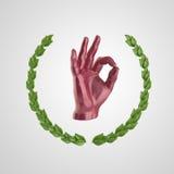 Metal la main humaine montrant le geste CORRECT, entouré par la guirlande d'or de laurier, d'isolement sur le rendu noir de fond Photographie stock libre de droits