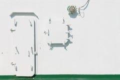 Metal la puerta y la ventana del listón abajo en la nave Imagen de archivo libre de regalías