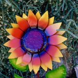 Metal Lacquered Flower Ornament in Nevada Cactus Nursery. Close up of metal lacquered flower garden ornament on display for sale at a little known cactus and royalty free stock photography
