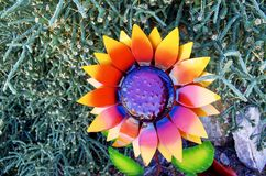 Metal Lacquered Flower Ornament in Nevada Cactus Nursery. Close up of metal lacquered flower garden ornament on display for sale at a little known cactus and royalty free stock images