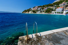 Metal Ladder on the Beach and Mediterranean Sea Stock Image