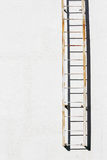 Metal ladder on cement wall Royalty Free Stock Photo