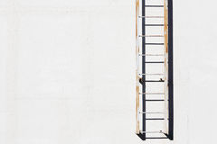 Metal ladder on cement wall Royalty Free Stock Image