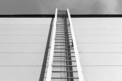 Metal ladder on industrial building in black and white style Royalty Free Stock Images