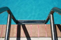 Ladder Into Pool Royalty Free Stock Photography