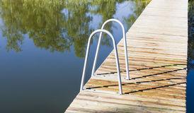 Metal ladder into the pool or lake Stock Photos