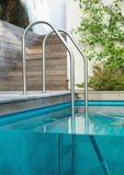 Metal ladder in a swimming pool Stock Photography