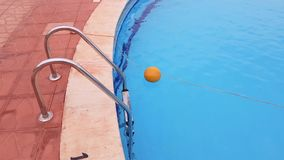 Metal ladder to the pool. In the pool is clear blue water. water activities stock video