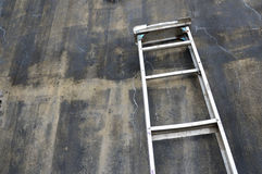Metal ladder. On the wall Royalty Free Stock Photography