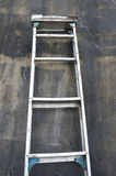 Metal ladder. On the wall Stock Photos