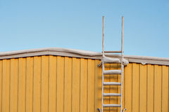 Metal ladder on yellow wall Royalty Free Stock Photography