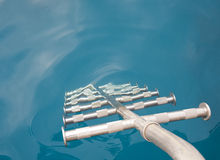 Metal ladders going into the water Royalty Free Stock Photo