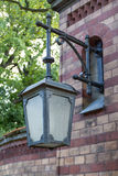 Metal lantern on a brick wall. With glass Royalty Free Stock Image