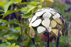 Metal lantern with floral design in green garden stock images