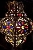 Metal lantern lit at night Stock Photo