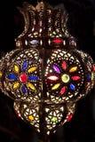 Metal lantern lit at night. Metal lantern lights up night Stock Photo