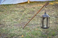 Metal lantern on a metal pole. Metal lantern on grass background stock photography