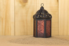 Metal lantern on sand Stock Photography