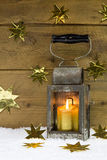 Metal lantern with wrapped gold presents and stars. Stock Images
