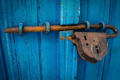 Metal latch on blue door Royalty Free Stock Photo