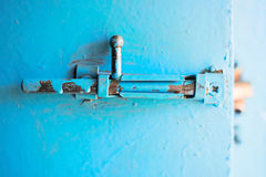 Metal latch on the door. Painted blue paint Royalty Free Stock Image