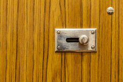 Metal latch on wooden door Royalty Free Stock Photos