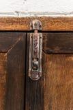 Metal latch on wooden door Stock Images
