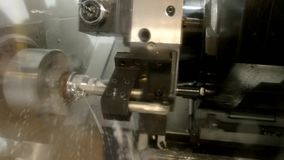 Metal lathe in action. Machine and water splashing stock video footage