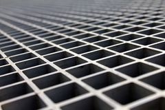 Metal lattice in the sun. Metal lattice in the spring sun with shadows royalty free stock photography