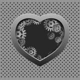 Metal le coeur avec les vitesses argentées sur le fond de fer Photographie stock