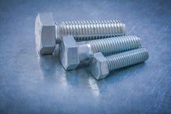 Metal les détails de boulon sur le concept d'entretien métallique de fond Photo libre de droits