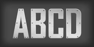 Metal letters. Over dark gray background Stock Image