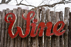 Metal letters spelling wine. Metal sign on fence spelling the word wine stock images