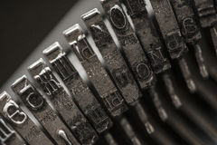 Metal letters on typewriter Royalty Free Stock Photos