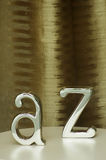 Metal Letters on a shop window. Two metal Letters A and Z on a shop window stock photos