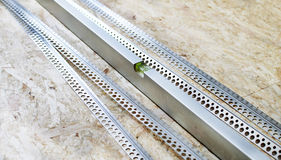 The metal level with perforated angles Stock Images