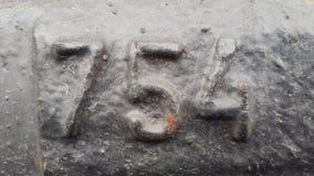 Metal liczba 754 Tekstura ośniedziały metal w postaci postaci 754 Zdjęcie Royalty Free