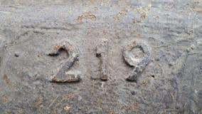 Metal liczba 219 Tekstura ośniedziały metal w postaci postaci 219 Obrazy Royalty Free