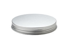 Metal lid of jar. Isolated on white background stock photography