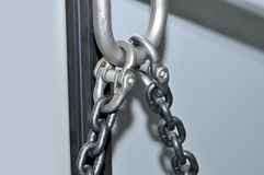 Metal lifting chains and carbines. Close up Royalty Free Stock Photos