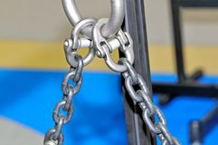 Metal lifting chains and carbines. Close up. Small depth of sharpness Stock Photo