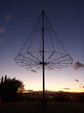 Metal Light Tree. The Kaimuki Christmas tree (Metal Light Tree) on top Pu'u O Kaimuki (also known as Menehune Hill) at dusk on with cityscape of Oahu, Hawaii Royalty Free Stock Images