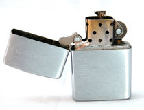 Metal lighter. A metal lighter on white background Royalty Free Stock Photos