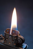 Metal lighter with flame. Royalty Free Stock Photography
