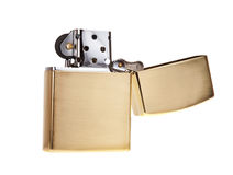 Metal lighter isolated on white background. Gold color Stock Images