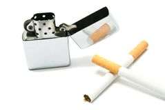 Metal lighter and two cigarettes on white Stock Photos
